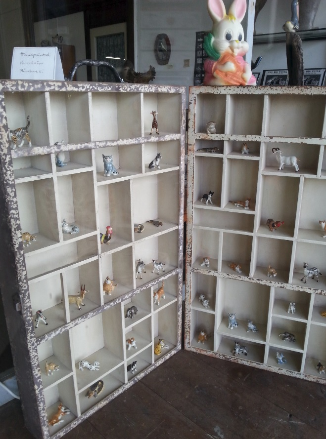Miniatures in the window of Sugden-Hamilton shop/studio