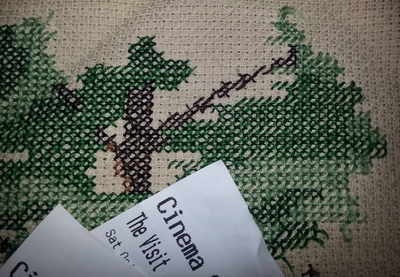 The Visit movie ticket with cross-stitch tree
