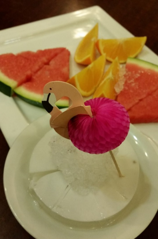 Paper flamingo, young coconut jelly and fruit